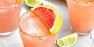 paloma cocktail in a glass with grapefruit slice as garnish